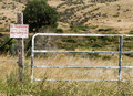 Gate and Fence on Rolling Hillside in Rural America Royalty Free Stock Photo