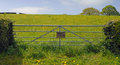 Gate into field showing a private keep out sign Royalty Free Stock Photo
