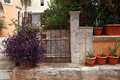 Gate and flowerpots in the greek courtyard of agia triada monastery Stock Images