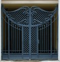 Gate from iron rods the closed shod with an openwork ornament black Stock Image