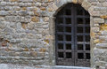 Gate old brown wooden in stone wall in the carcassonne castle Royalty Free Stock Image