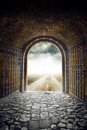 Gate opening to endless road leading nowhere old arch country hopelessness and great unknown concept Stock Photography