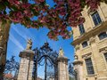 The gate of the residence in würzburg with some cherry trees Royalty Free Stock Photo