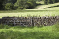 Gate and stone wall between fields Royalty Free Stock Photography