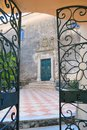 Gate to greek monastery and opened iron ornamental Stock Images