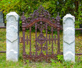 Gate to nowhere rusty with white columns Royalty Free Stock Photography