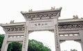Gate to the Po Lin Monastery in Ngong Ping Village, Lantau Island, Hong Kong Royalty Free Stock Photo