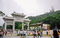 Gate to the Po Lin Monastery with Tian Tan Buddha statue up on the hill in Ngong Ping Village, Lantau Islan Royalty Free Stock Photo