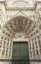 Gate to sevilla cathedral beautiful carved bas relief and green door of assumption Royalty Free Stock Image