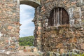 Gate at the torrent fortress bohus faestning has been sieged times but neve concured now a ruin http www bohusfastning com sv se Royalty Free Stock Images