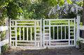 Gates to the garden old vintage a lush summer Royalty Free Stock Image