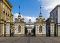 Gates of warsaw university and the main building poland Stock Photos