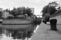 Gateway on the river in summer black and white Royalty Free Stock Photo