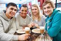Gathered in cafe image of teenage friends spending time Royalty Free Stock Image