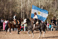 A Gaucho with Argentinian flag riding a horse in e Royalty Free Stock Photo