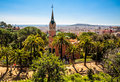 Gaudi house park guell barcelona s surrounded by palms trees in in spain Royalty Free Stock Image