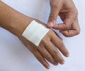 Gauze bandage the hand Royalty Free Stock Photo