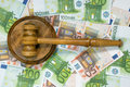 Gavel and banknotes wood soundblock on a background of Stock Photo