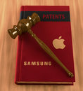 Gavel on a book of patents Royalty Free Stock Photo