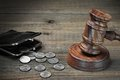 Gavel, Empty Purse, Coins, And Old Book On Wooden Table Royalty Free Stock Photo