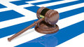 Gavel on the flag of Greece Stock Photo