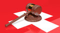 Gavel on the flag of Switzerland Stock Image