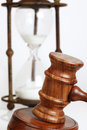 Gavel with Hourglass Behind Royalty Free Stock Photography