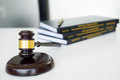 gavel Judge hammer with legal book on brown wooden desk with cop