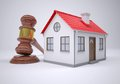 Gavel and small house the gray background Royalty Free Stock Photos