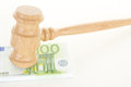 Gavel with some money made of oak wood Royalty Free Stock Photos