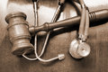 Gavel and stethoscope on wooden background Stock Images