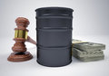 Gavel wads money and barrel of oil the gray background Stock Images