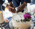 Gay Couple Hands Cutting Wedding Cake Royalty Free Stock Photo