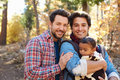 Gay Male Couple With Baby Walking Through Fall Woodland Royalty Free Stock Photo
