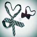 Gay marriage a tie and a bow tie forming hearts and wedding rings depicting the concept with a retro effect Royalty Free Stock Images
