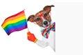 Gay pride dog waving a rainbow flag behind banner Royalty Free Stock Photography