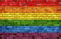 Gay pride flag on a brick wall