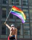 Gay pride flag waving man rainbow in parade Royalty Free Stock Photos