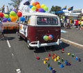 Gay pride parade van a is decorated with balloons and colorful tied on cans as a driving participant in the san diego Royalty Free Stock Photos