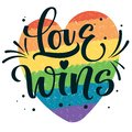 Gay Pride text Love Wins with splashes and dots decor on colorful gay rainbow heart background