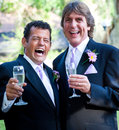 Gay wedding champagne and laughter happy couple enjoying laughing Stock Images