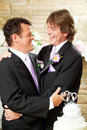 Gay Wedding Couple Embrace Stock Image