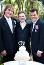 Gay wedding couple with minister handsome and their at their Stock Photography