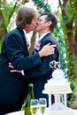 Gay wedding romantic kiss two grooms kissing each other at their reception Stock Photo
