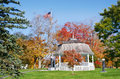 Gazebo in autumn park white surrounded by colors a city new england Royalty Free Stock Photos