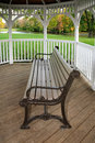 Gazebo banch a park bench inside a at the park in autumn southwestern ohio usa pastoral rural resting place Royalty Free Stock Images