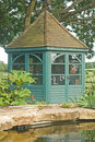 Gazebo beside fish pond in garden. Royalty Free Stock Photography