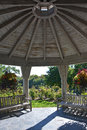 Gazebo interior and benches in a garden Stock Photo