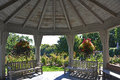 Gazebo interior structure with hanging baskets Royalty Free Stock Photography