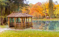 Gazebo on the lake park in autumn Royalty Free Stock Images